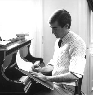 photo: David Earl composing at the piano